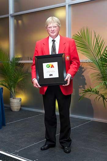 John Kehler of Home Hardware Vernon Holding his Award
