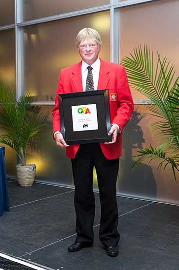 John Kehler of Home Hardware Vernon Holding his Award
